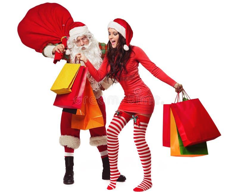 Άγιος Βασίλης με τη χαμογελώντας γυναίκα στοκ εικόνα με δικαίωμα ελεύθερης χρήσης