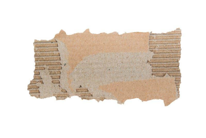 Άκρο σχισμένο από χαρτόνι Κομμάτι χαρτιού απομονωμένο στοκ εικόνα με δικαίωμα ελεύθερης χρήσης
