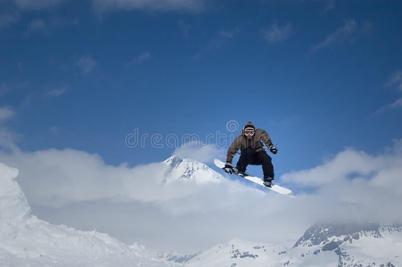 άλμα snowboarder στοκ φωτογραφία