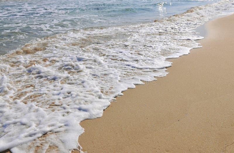 Άμμος και κύμα στοκ φωτογραφίες