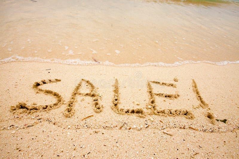 άμμος πώλησης επιγραφής στοκ φωτογραφίες