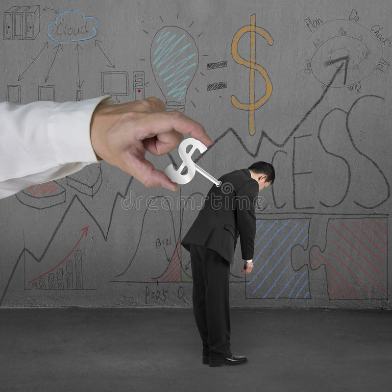 Άνεμος κουρδιστήρι χρημάτων στο άτομο με το επιχειρησιακό doodles υπόβαθρο στοκ εικόνες με δικαίωμα ελεύθερης χρήσης