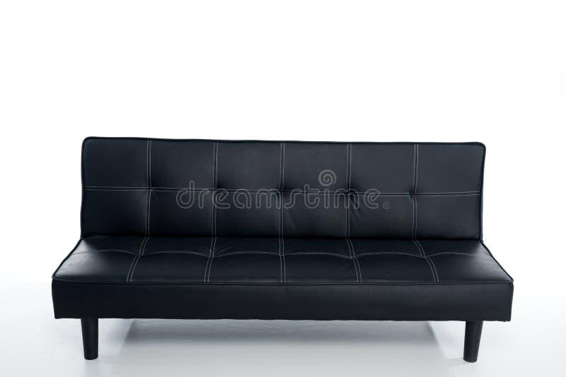 άνετος κενός μαύρος καναπές στοκ εικόνες
