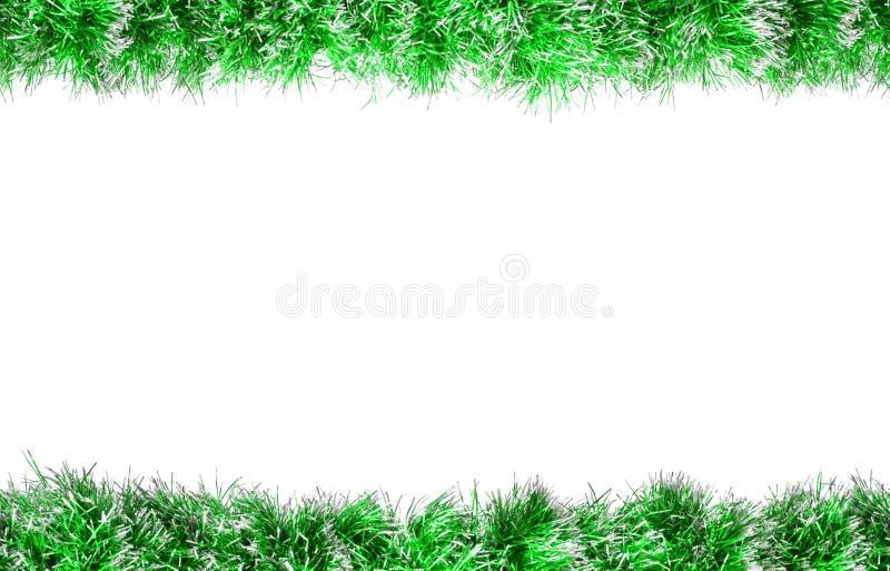 Άνευ ραφής πράσινο ασημένιο tinsel Χριστουγέννων πλαίσιο η ανασκόπηση απομόνωσε το λευκό στοκ φωτογραφία με δικαίωμα ελεύθερης χρήσης