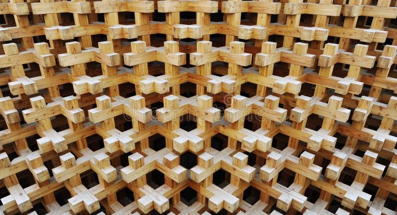 Άνευ ραφής σύσταση των ξύλινων φραγμών στο υπόβαθρο κολάζ Επαναλαμβανόμενοι σταυροί με την τρισδιάστατη επίδραση στοκ εικόνες