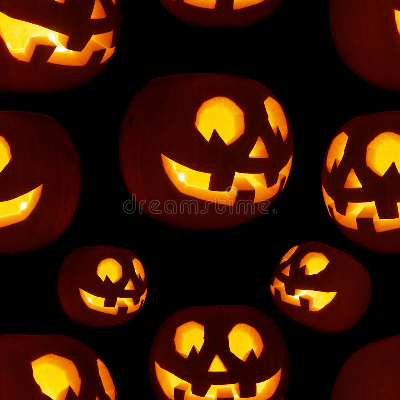 Άνευ ραφής Jack-o'-lanterns σχέδιο κολοκύθας στοκ εικόνες