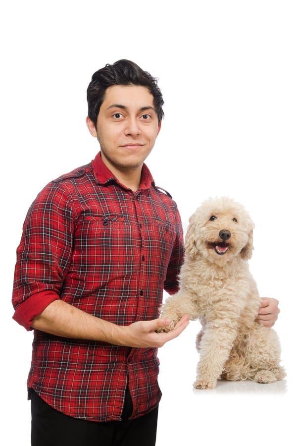 Download Άνδρας με το σκυλί που απομονώνεται νεαρός στο λευκό Στοκ Εικόνα - εικόνα από μικροσκοπικός, ελάχιστα: 62710253