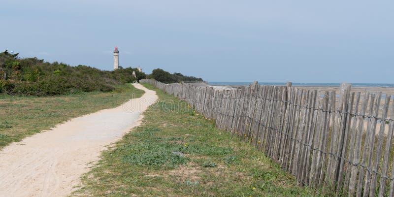 Άποψη αλεών πορειών περιπάτων του φάρου Baleines Ile de Re Γαλλία στο πρότυπο εμβλημάτων Ιστού στοκ φωτογραφία με δικαίωμα ελεύθερης χρήσης