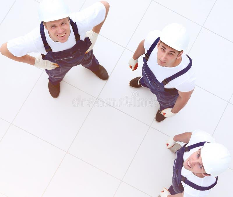 Άποψη από την κορυφή - ομάδα εργατών οικοδομών στοκ εικόνα
