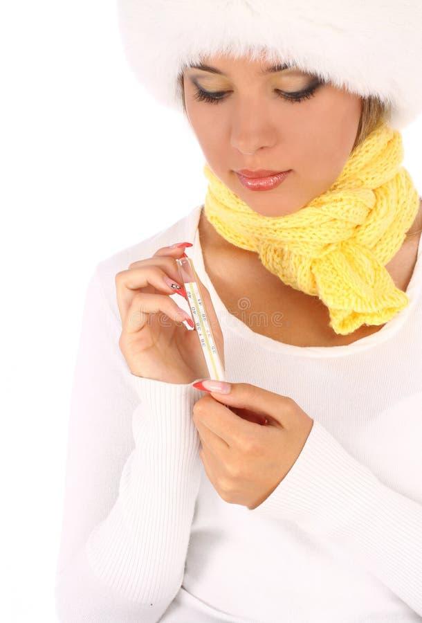 Άρρωστο θερμόμετρο εκμετάλλευσης κοριτσιών στοκ φωτογραφία