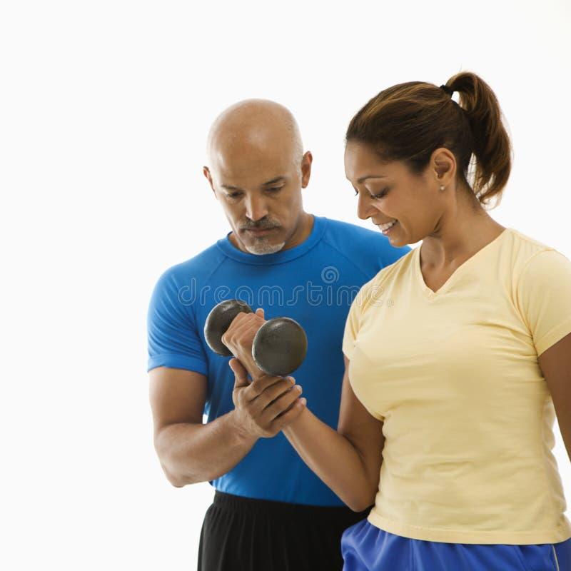 άσκηση της γυναίκας ανδρών στοκ εικόνα με δικαίωμα ελεύθερης χρήσης