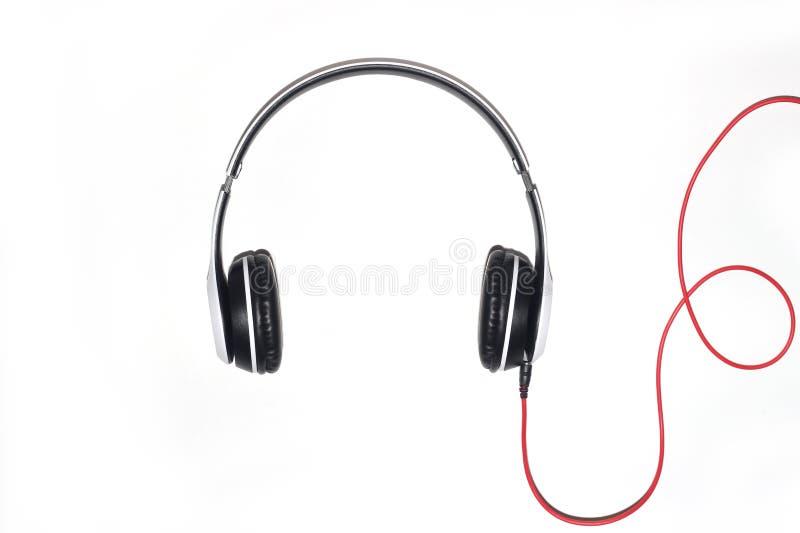 Άσπρα ακουστικά που απομονώνονται σε ένα άσπρο υπόβαθρο στοκ φωτογραφία με δικαίωμα ελεύθερης χρήσης