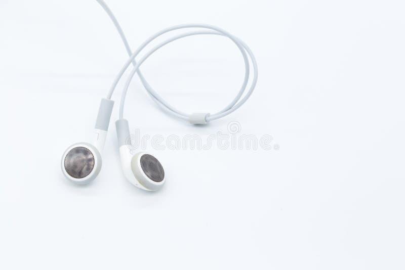 Άσπρα earbuds στοκ φωτογραφία με δικαίωμα ελεύθερης χρήσης