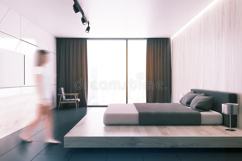 Άσπρη κρεβατοκάμαρα σοφιτών με μια συσκευή τηλεόρασης μια πλάγια όψη που τονίζεται απεικόνιση αποθεμάτων