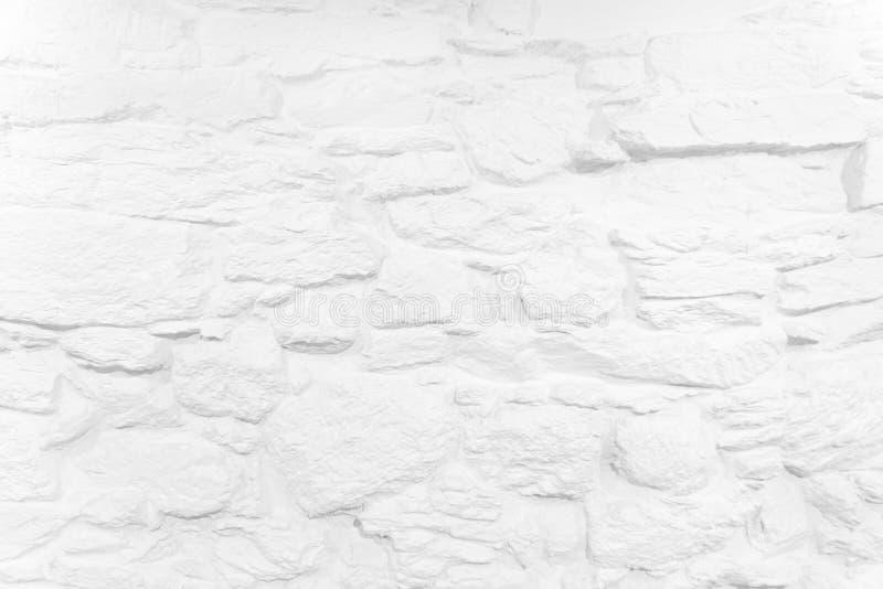 Άσπρος ασπρισμένος υπόβαθρο τοίχος πετρών στοκ εικόνες