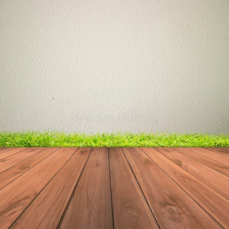 Άσπρος τοίχος ασβεστοκονιάματος τσιμέντου και ξύλινο πάτωμα στοκ φωτογραφία με δικαίωμα ελεύθερης χρήσης