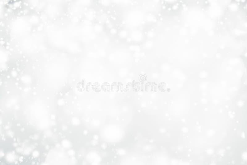 Άσπρο υπόβαθρο bokeh Χριστουγέννων αφηρημένο με snowflake και sil στοκ φωτογραφία
