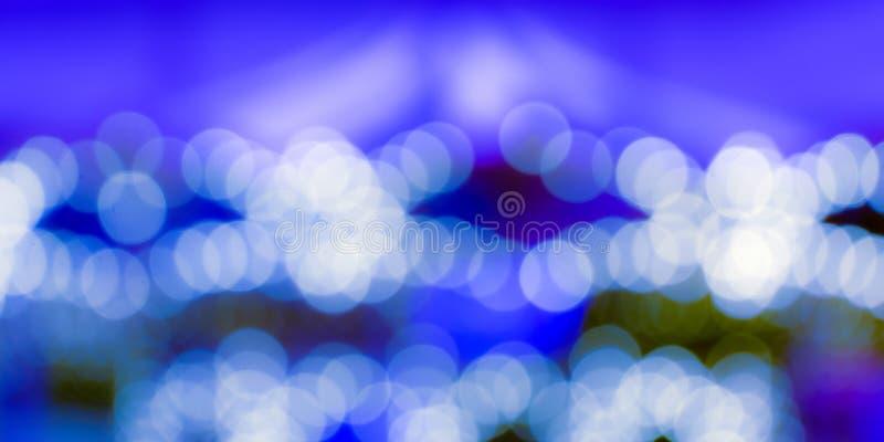 Άσπρο bokeh στην μπλε ανασκόπηση στοκ φωτογραφία με δικαίωμα ελεύθερης χρήσης