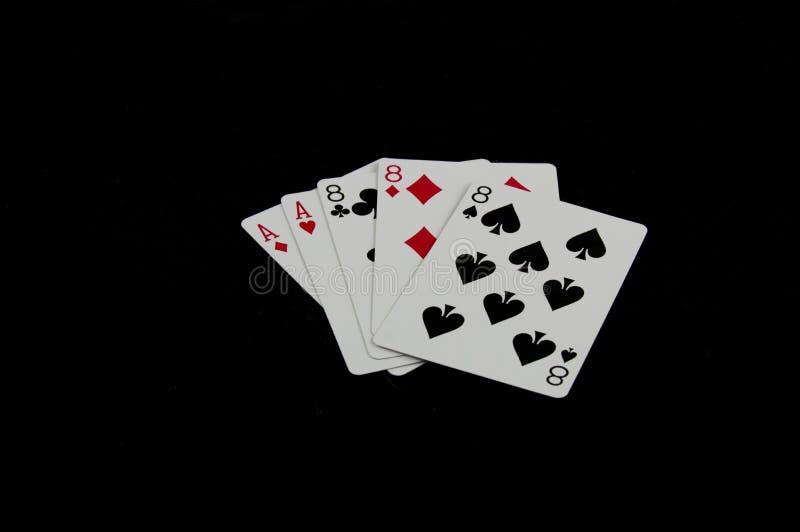 Άσσοι και νεκρό ανθρώπινο χέρι Eights στοκ εικόνα με δικαίωμα ελεύθερης χρήσης