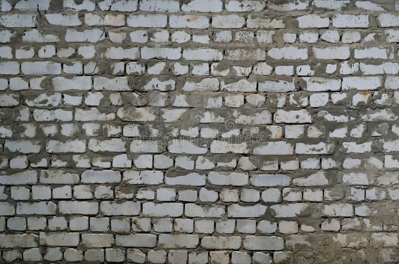Άσχημος τοίχος του άσπρου τούβλου στοκ φωτογραφία
