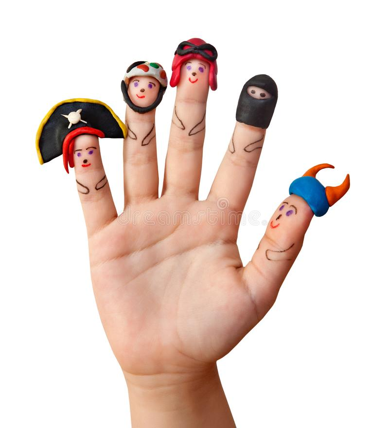 Άτομα δάχτυλων με στα καπέλα ατόμων ` s από τον άργιλο στοκ εικόνα με δικαίωμα ελεύθερης χρήσης