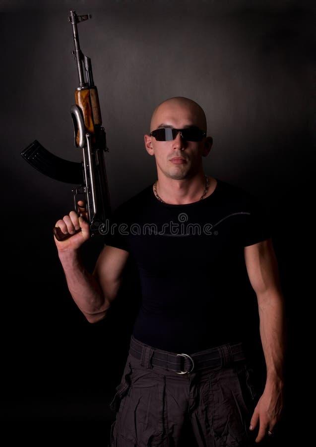 άτομα πυροβόλων όπλων στοκ εικόνες