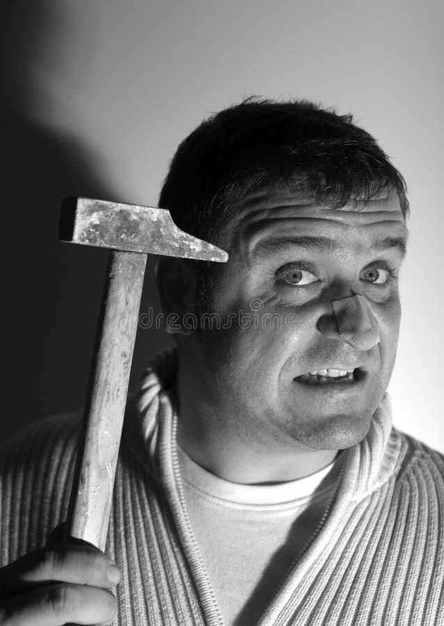 άτομο εκμετάλλευσης σφυριών στοκ εικόνα με δικαίωμα ελεύθερης χρήσης