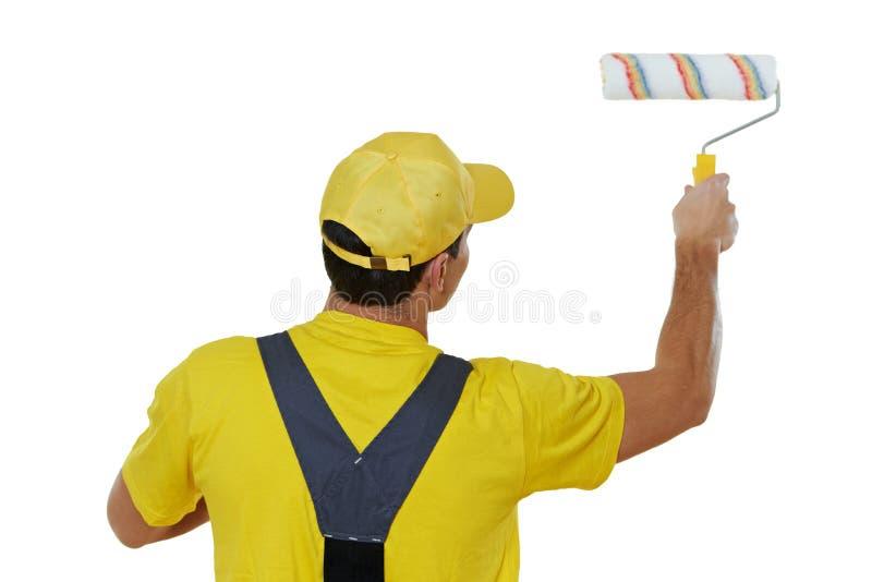 Άτομο ζωγράφων σε ομοιόμορφο με τον κύλινδρο χρωμάτων στοκ φωτογραφία