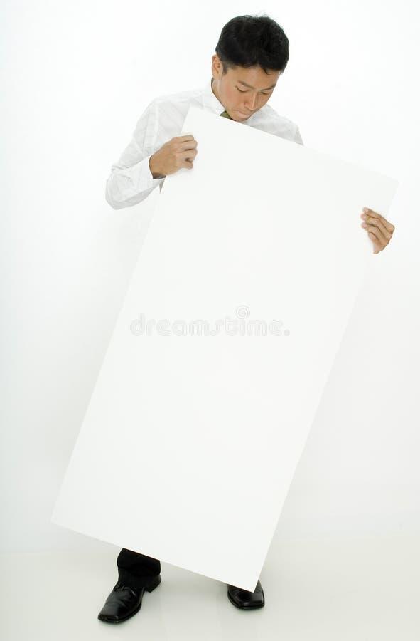 Άτομο και σημάδι στοκ εικόνα με δικαίωμα ελεύθερης χρήσης