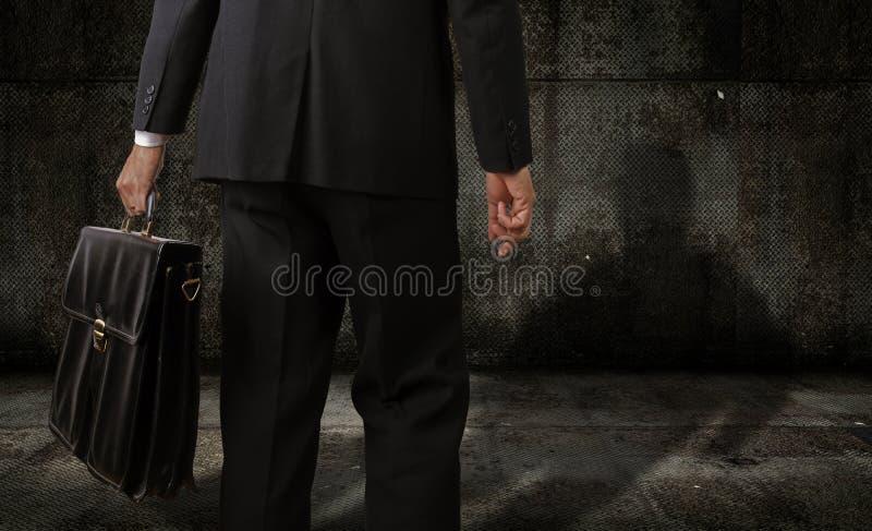 Άτομο με έναν χαρτοφύλακα στοκ φωτογραφία με δικαίωμα ελεύθερης χρήσης