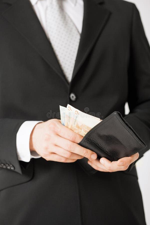Άτομο με τα ευρο- χρήματα μετρητών στοκ εικόνα