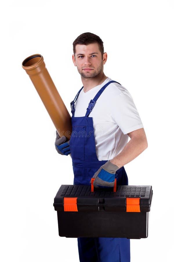 Άτομο με την εργαλειοθήκη και την υδρορροή στοκ εικόνες