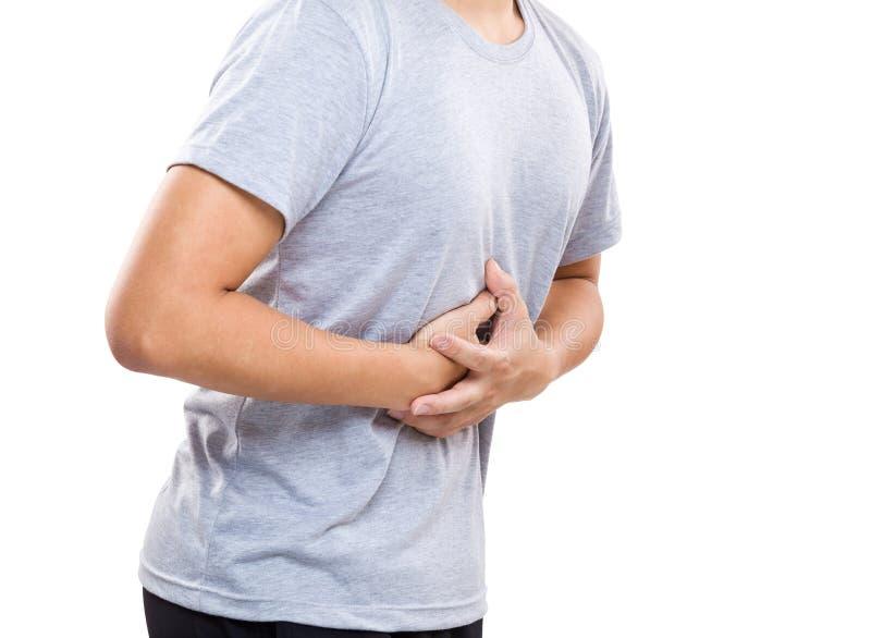 Άτομο με τον ισχυρό πόνο στομαχιών στοκ εικόνες