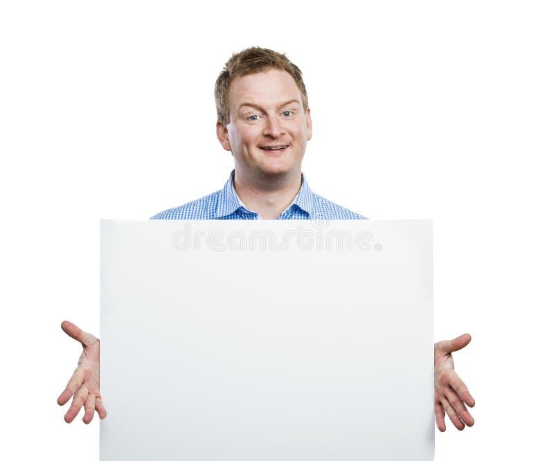 Άτομο με τον κενό πίνακα σημαδιών στοκ φωτογραφίες με δικαίωμα ελεύθερης χρήσης