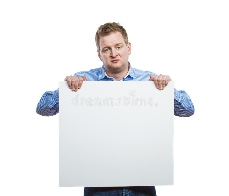 Άτομο με τον κενό πίνακα σημαδιών στοκ φωτογραφίες