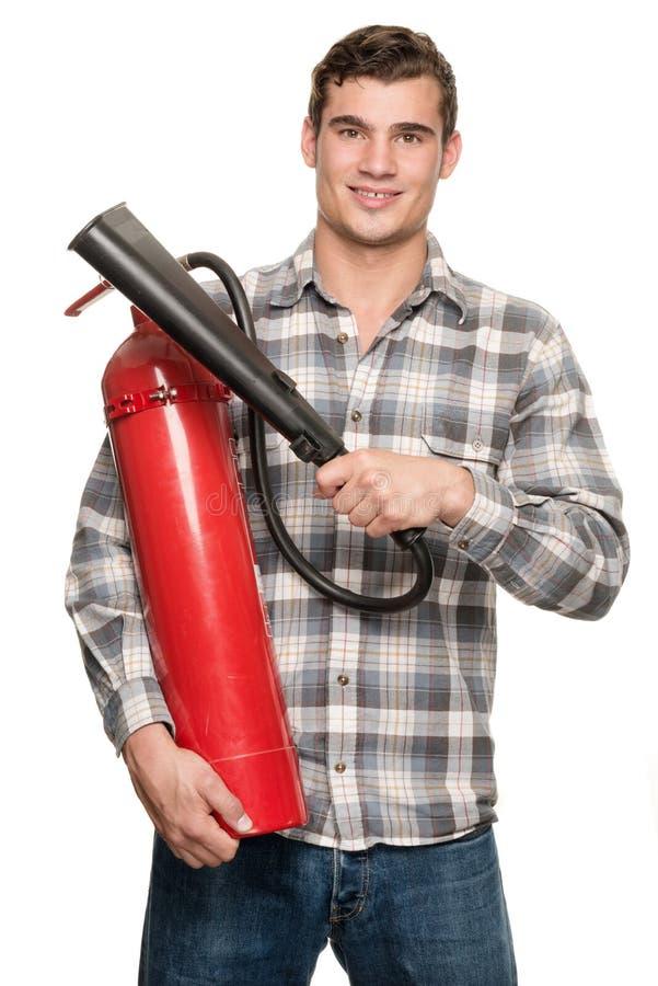 Άτομο με τον πυροσβεστήρα στοκ φωτογραφία με δικαίωμα ελεύθερης χρήσης