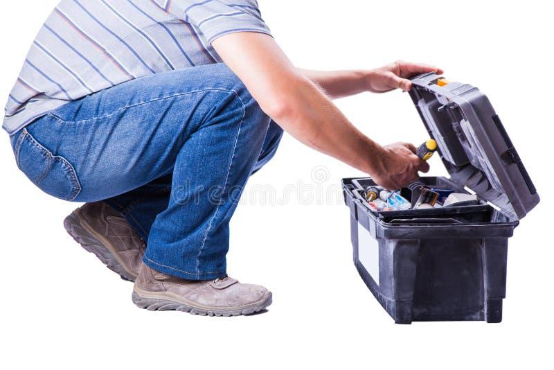 Άτομο με το κιβώτιο εργαλείων στοκ εικόνα