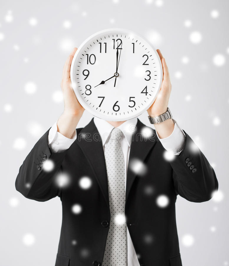 Άτομο με το ρολόι τοίχων στοκ εικόνα με δικαίωμα ελεύθερης χρήσης