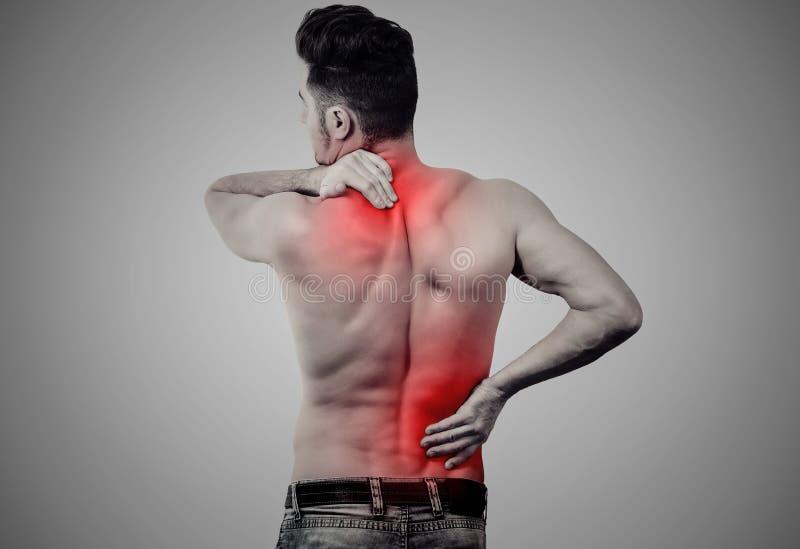 Άτομο με το χαμηλότερο και ανώτερο πόνο στην πλάτη στοκ εικόνα