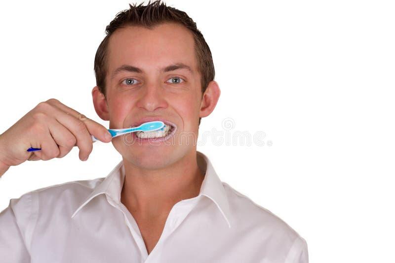 Άτομο που βουρτσίζει τα δόντια του στοκ εικόνα με δικαίωμα ελεύθερης χρήσης