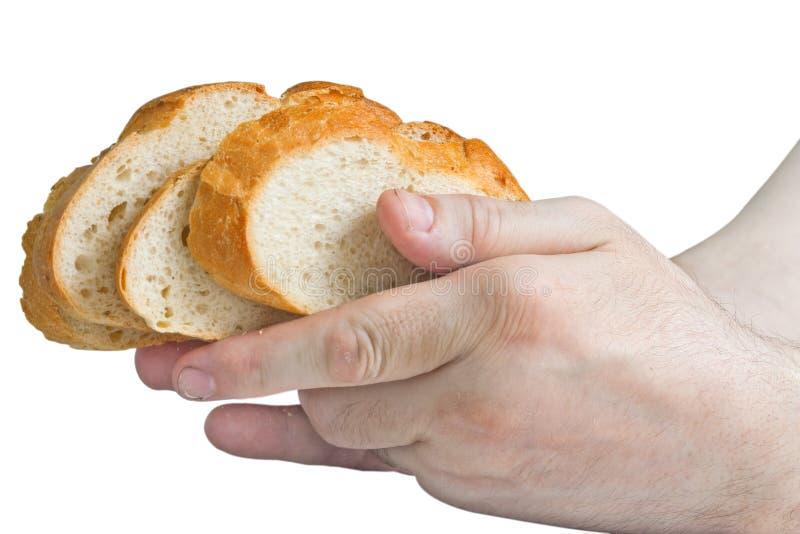 Άτομο που κρατά τις άσπρες φέτες ψωμιού στα χέρια του στοκ φωτογραφίες με δικαίωμα ελεύθερης χρήσης