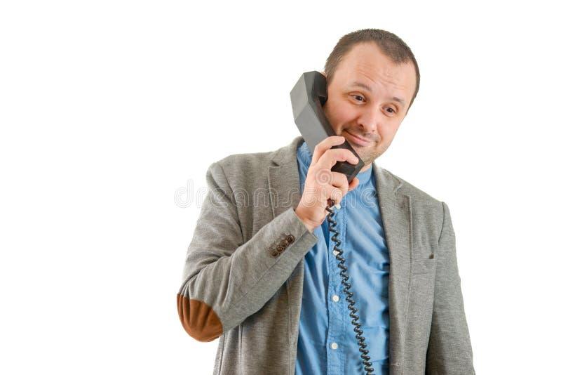 Άτομο που μιλά σε ένα παλαιό τηλέφωνο, που απομονώνεται στο άσπρο υπόβαθρο στοκ φωτογραφίες με δικαίωμα ελεύθερης χρήσης