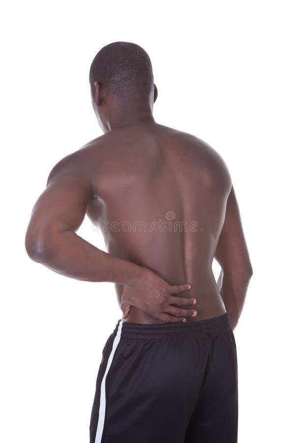 Άτομο που πάσχει από τον πόνο στην πλάτη στοκ εικόνα