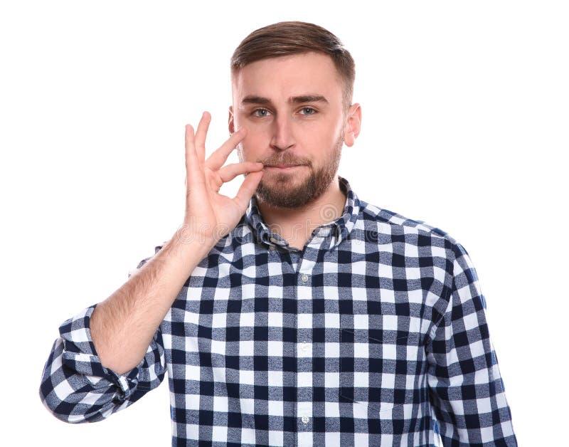 Άτομο που το στόμα του στο λευκό Χρησιμοποίηση της γλώσσας σημαδιών στοκ εικόνα με δικαίωμα ελεύθερης χρήσης