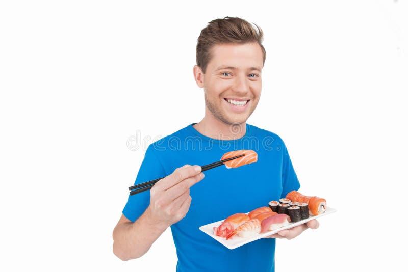 Άτομο που τρώει τα σούσια. στοκ εικόνες