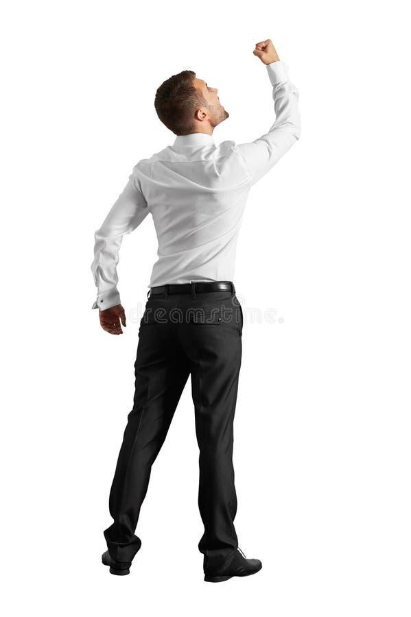 Άτομο που φαίνεται επάνω και που παρουσιάζει πυγμή στοκ εικόνες