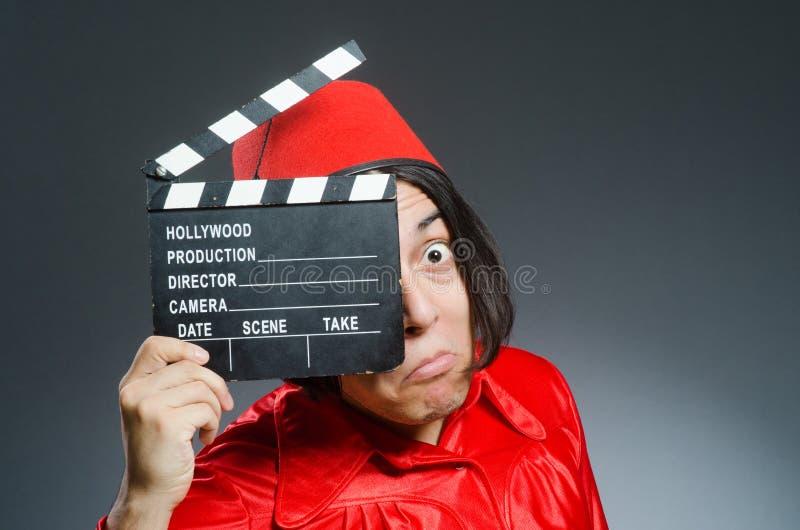 Download Άτομο που φορά το κόκκινο καπέλο του Fez Στοκ Εικόνες - εικόνα από μόδα, chalkboard: 62705084