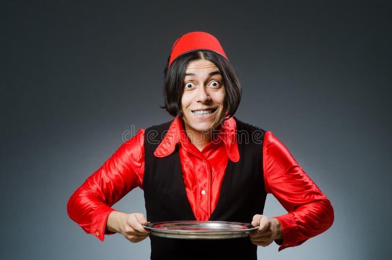Download Άτομο που φορά το κόκκινο καπέλο του Fez Στοκ Εικόνα - εικόνα από κόκκινος, μέση: 62705089