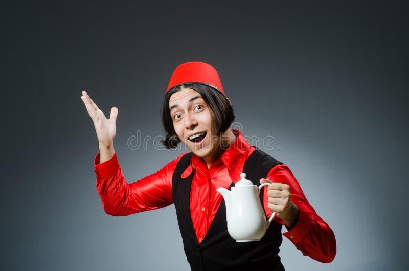 Download Άτομο που φορά το κόκκινο καπέλο του Fez Στοκ Εικόνα - εικόνα από αρσενικό, μουσουλμάνος: 62705151