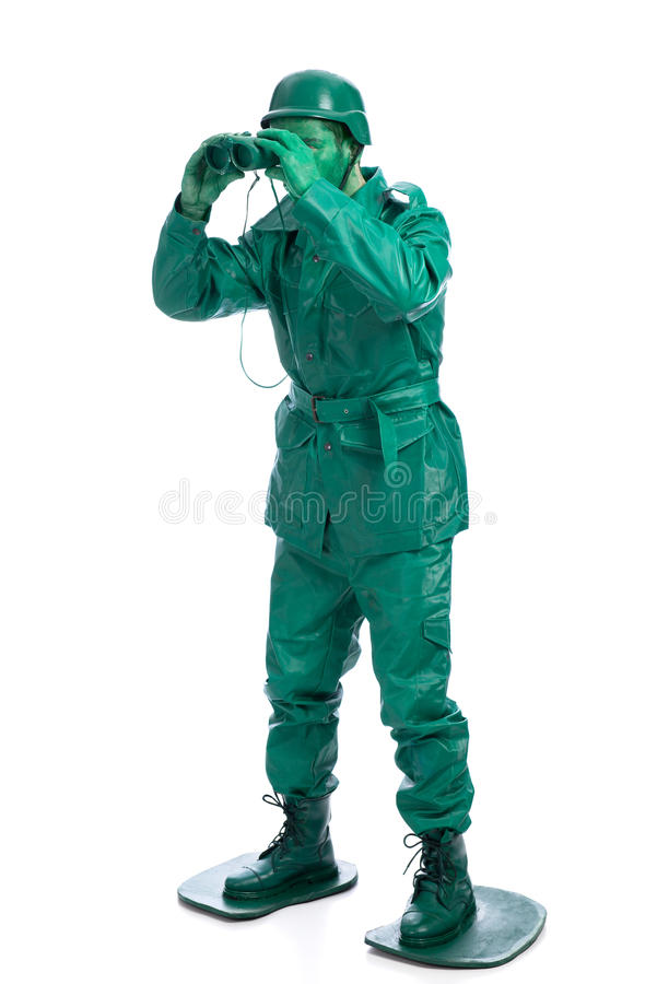 Άτομο σε ένα πράσινο κοστούμι στρατιωτών παιχνιδιών στοκ εικόνες